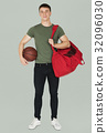 Young adult muscular man holding basketball 32096030