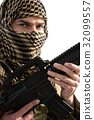 Portrait of soldier holding a rifle 32099557