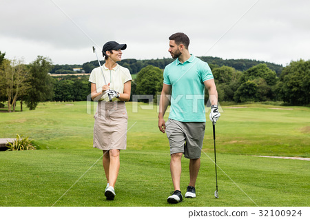 Couple interacting with each other while walking 32100924