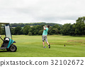 Rear view of man playing golf 32102672