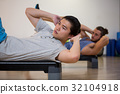 Two men doing aerobic exercise on stepper 32104918