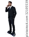 Businessman on hoverboard talking on mobile phone 32105539