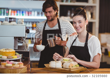 Waiter and waitress working behind the counter 32105660