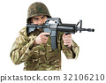 Soldier aiming with a rifle 32106210