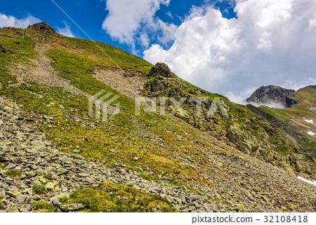 Steep slope on rocky hillside in clouds 32108418