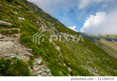 Steep slope on rocky hillside in clouds 32108419