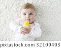 Cute adorable ewborn baby girl holding nursing 32109403