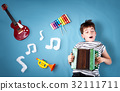 boy on blue blanket background with accordion 32111711