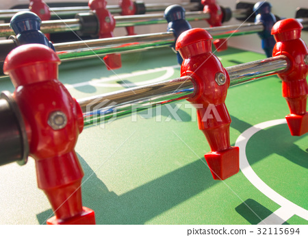Table football game with red and blue players team 32115694