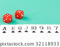 Dices and cards on green casino table 32118933