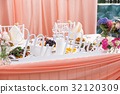 Table set for wedding banquet with flowers 32120309