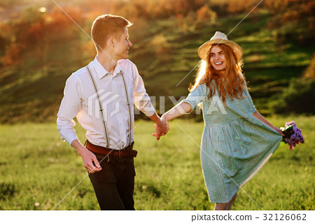 A young man walks with his girlfriend in the park 32126062