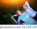 young couple lying on the grass and relax 32126138