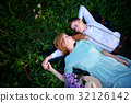 young couple lying on the grass and relax 32126142