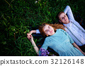 young couple lying on the grass and relax 32126148