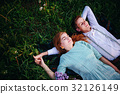 young couple lying on the grass and relax 32126149