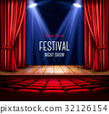 A theater stage with a red curtain and a spotlight 32126154