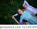 young couple lying on the grass and relax 32126169