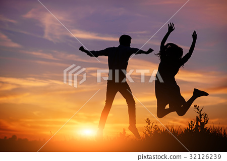 A young man with his girlfriend jump on background 32126239