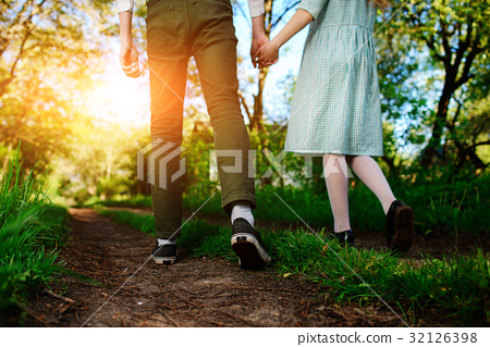 man goes with his girlfriend on the road,  32126398