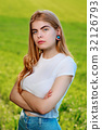 beautiful woman with wooden tunnels in her ears 32126793