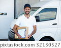 Portrait of delivery man holding parcels and clipboard 32130527
