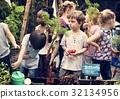 Group of kindergarten kids learning gardening outdoors 32134956