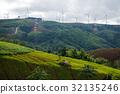Green rice field on mountain with wind turbine 32135246