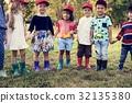 Group of kids school field trips learning outdoors botanic park 32135380
