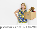 Woman Studio Portriat Casual Carrying a Box Isolated 32136299