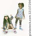 Children Girlfriends Smiling Happiness Friendship Togetherness Studio Portrait 32137204
