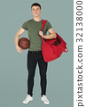 Young adult muscular man holding basketball 32138000