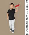 Little Boy Holding Paper Plane Studio Portrait 32138229