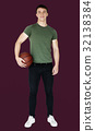 Young adult muscular man holding basketball 32138384