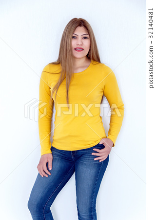 Young girl with long brown healthy hair in yellow 32140481