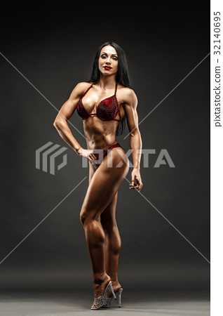 Strong and muscular sports girl in bikini posing 32140695