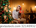 Young Man Holding Small Present 32140932