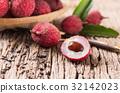 fresh organic lychee fruit on wood 32142023