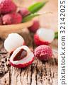 half fresh organic lychee fruit on wood 32142025