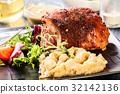 Pork knuckle with fried sauerkraut 32142136