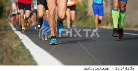 Marathon running race, people feet on city road 32144208