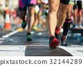 Marathon running race,drinks station at a marathon 32144289