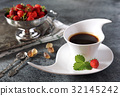 Wild strawberries and cup of black coffee 32145242
