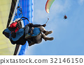 Two paraglider tandem fly against the blue sky 32146150