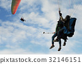 Two paraglider tandem fly against the blue sky 32146151
