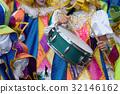 Boy drumming at carnival 32146162