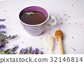 Lavender tea with fresh flowers and sugar stick 32146814