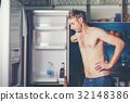 Hungry man looking for food in refrigerator 32148386