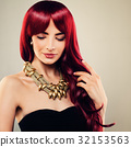 Beautiful Redhead Woman with Healthy Wavy Hair 32153563
