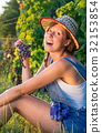 Happy woman eating grapes in vineyard 32153854